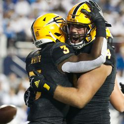Arizona State running back Rachaad White (3) and offensive lineman Kellen Diesch celebrate a touchdown during an NCAA college football game against BYU at LaVell Edwards Stadium in Provo on Saturday, Sept. 18, 2021.