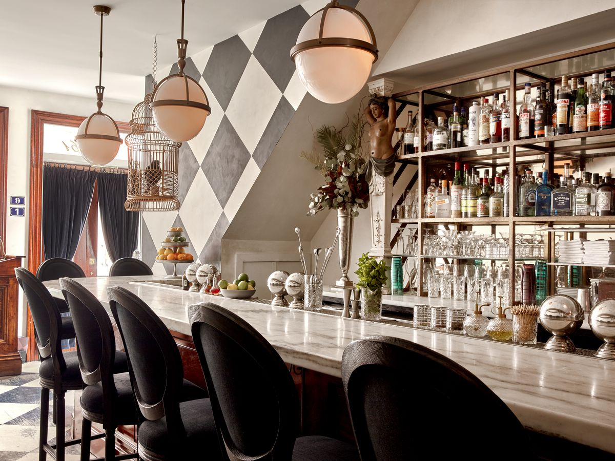 fancy bar with marble top and black and white checkered floor