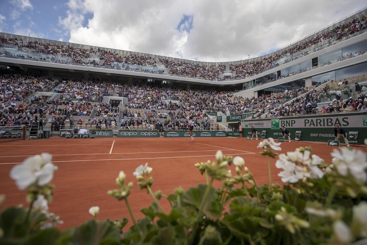 A general view as Novak Djokovic serves during his match against Dominic Thiem on day 14 of the 2019 French Open at Stade Roland Garros.