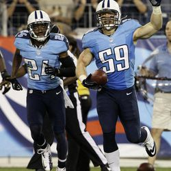 Tennessee Titans linebacker Tim Shaw (59) celebrates with cornerback Coty Sensabaugh (24) after intercepting a pass against the New Orleans Saints in the third quarter of an NFL football preseason game on Thursday, Aug. 30, 2012, in Nashville, Tenn.