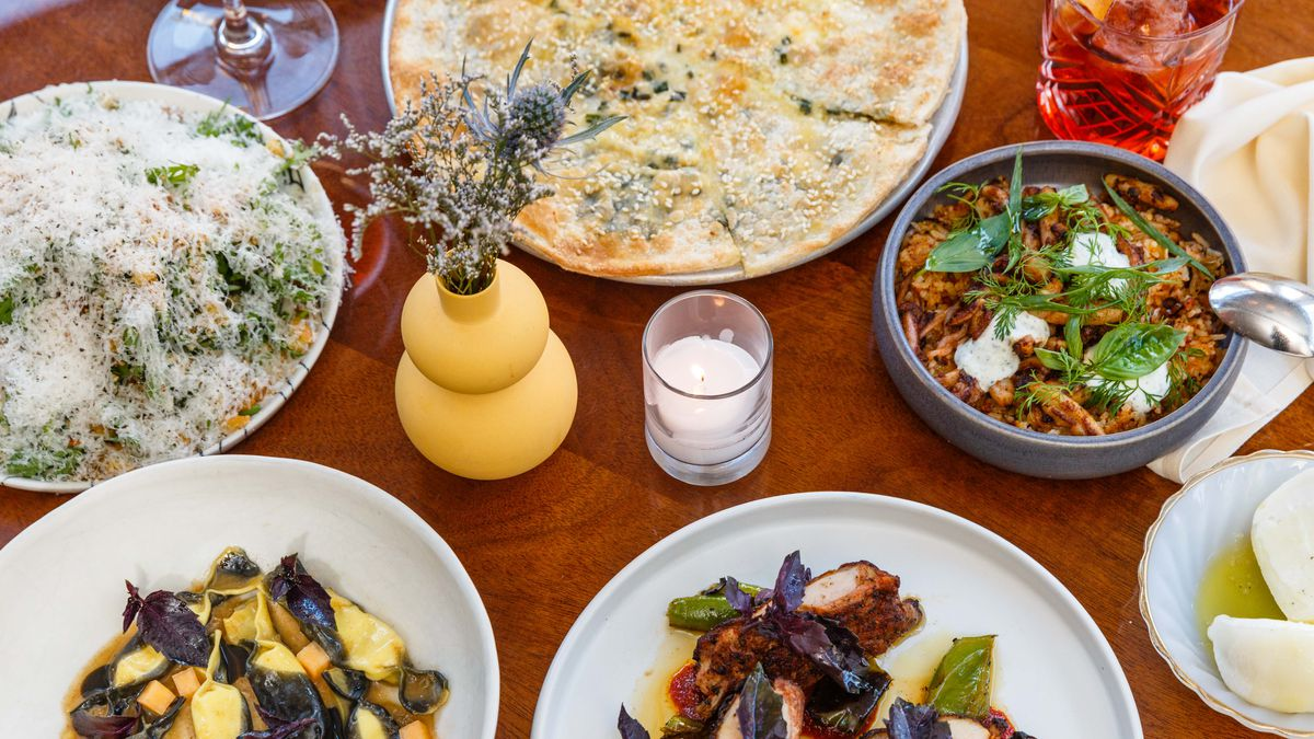 a spread of italian american dishes at don angie - Olive Garden Las Vegas