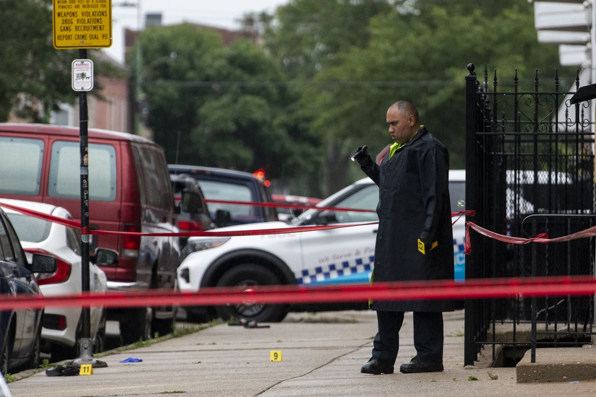 Chicago police work the scene where 3 people were shot, including 1 person who was shot and killed, in the 1800 block of South Paulina, in the Pilsen neighborhood, Saturday, July 10, 2021.   Tyler LaRiviere/Sun-Times