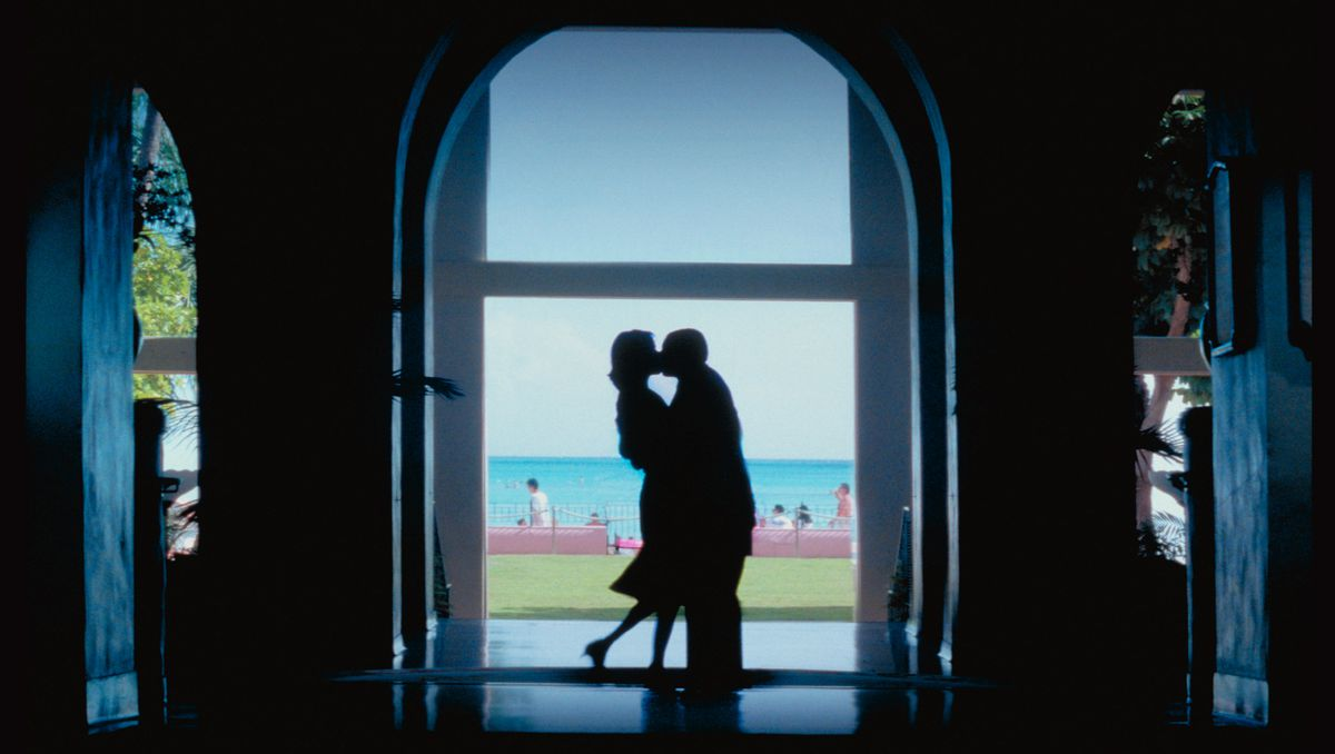 Emily Watson and Adam Sandler in silhouette in Punch-Drunk Love.