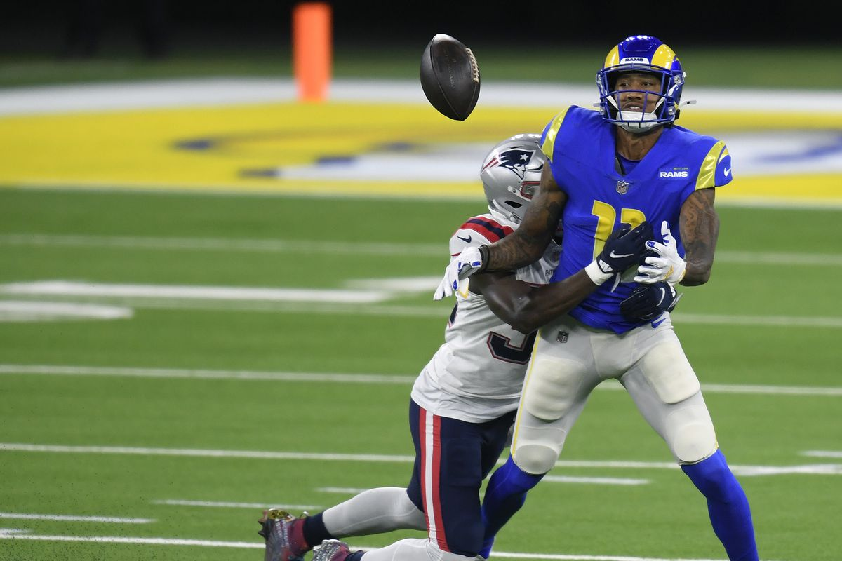 Josh Reynolds #11 of the Los Angeles Rams drops a pass as he is hit by Devin McCourty #32 of the New England Patriots during a 24-3 Los Angeles Rams win at SoFi Stadium on December 10, 2020 in Inglewood, California.