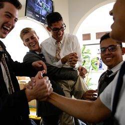 Elders Tanner McKee, Adam Christensen, Nicolas Rodrigues, Pedro Cabral and Henrique Melo greet each other at the mission office in Curitiba, Brazil, on Monday, June 3, 2019. On transfer day, missionaries return to the office where they are assigned new companions and dispatched to a new area of the mission.
