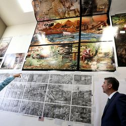 """Tom Holdman, left, and Utah Valley University President Matthew Holland look at the sketches for the """"Roots of Knowledge"""" stained-glass project at Holdman Studios at Thanksgiving Point in Lehi on Friday, Sept. 16, 2016. A Guardian UK reporter called the work """"one of the most spectacular stained glass windows made in the past century."""""""