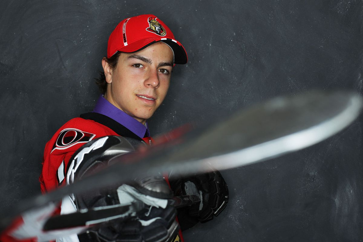 """""""Jean-Gabriel, no. We have a lot of draft picks to photograph. Get the stick out of the lens, please."""""""