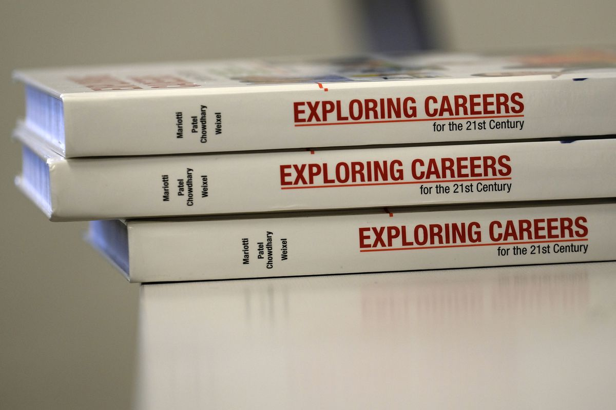 """""""Exploring Careers"""" books on a desk at Crispus Attucks High School, a public school in Indianapolis, Indiana. — April 2019 — Photo by Alan Petersime/Chalkbeat"""