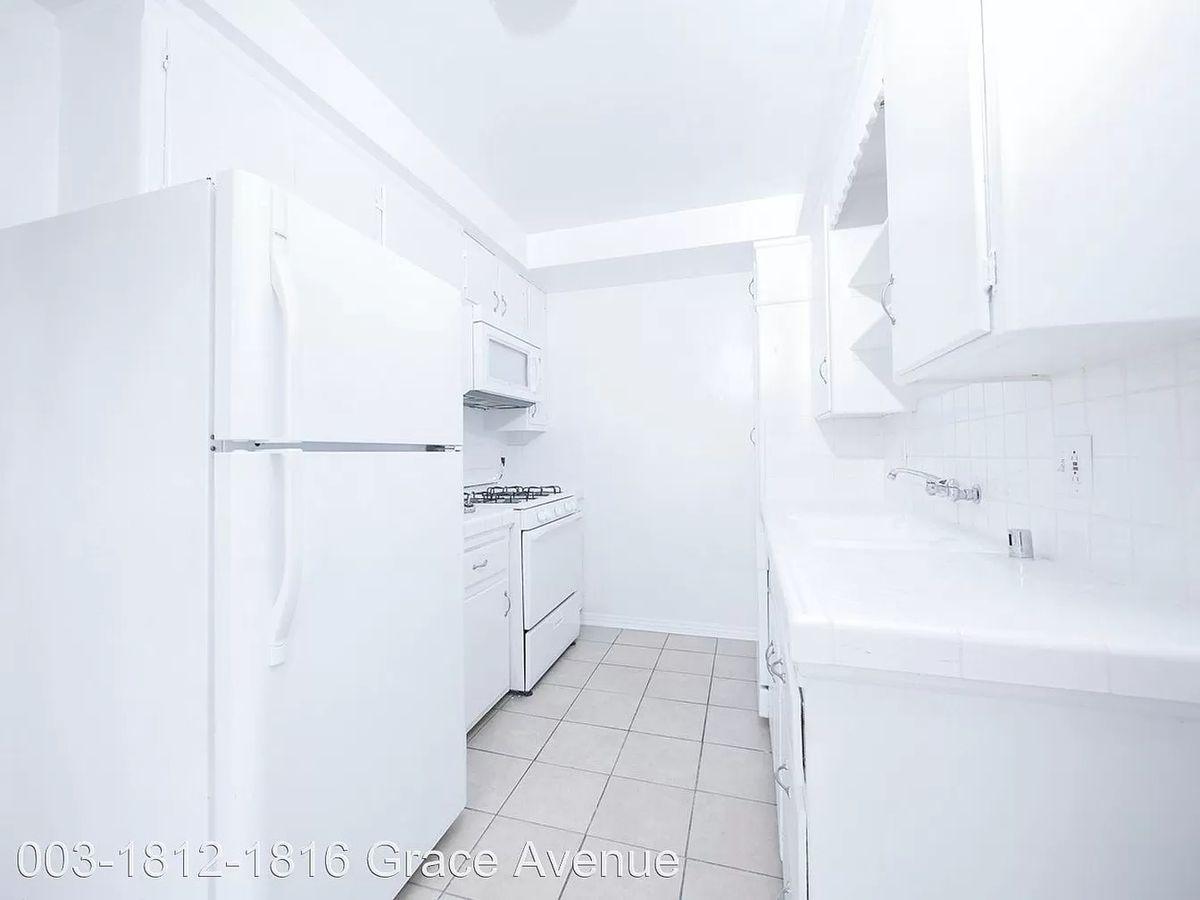 Kitchen with white walls and white appliances