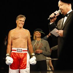 Former Massachusetts Gov. Mitt Romney, left, is announced in the ring during the Charity Vision Fight Night event in Salt Lake City, Friday, May 15, 2015.