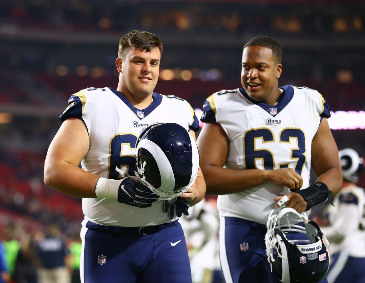 Los Angeles Rams C Austin Blythe walks with OT Darrell Williams during the Rams' Week 13 game against the Arizona Cardinals, December 3, 2017.
