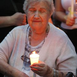 Sgt. Derek Johnson's grandmother Norma Johnson holds a candle during a vigil is held in his honor in Draper Sunday, Sept. 1, 2013. Johnson was shot and killed this morning.