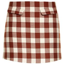 A checkered mini-skirt in a rusty red is the epitome of summer and picnic blankets and what not.