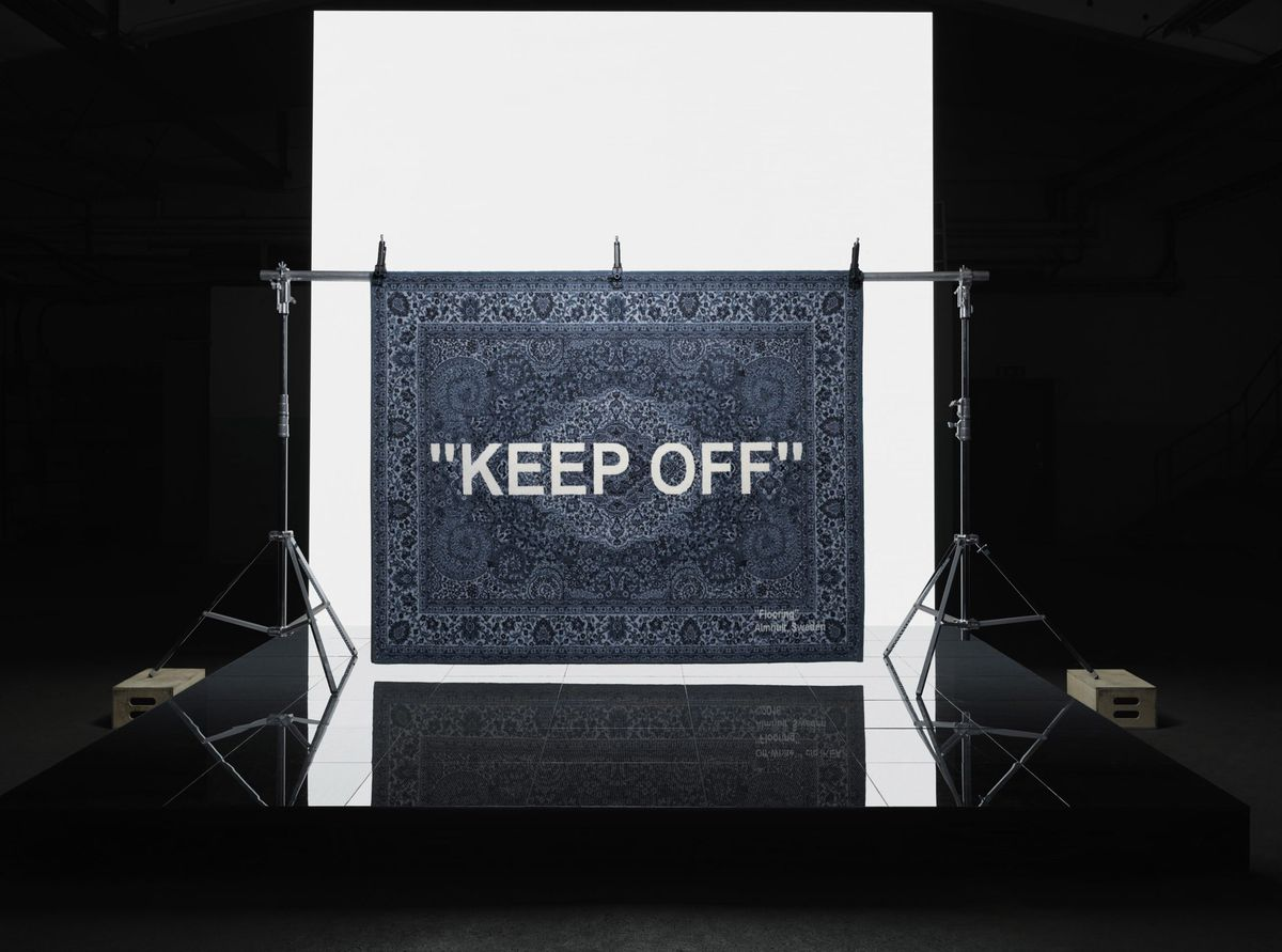 """Blue rug with with the words """"keep off"""""""