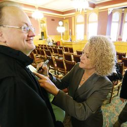 Mayor-elect Jackie Biskupski signs an autograph for Chuck Whyte after the Salt Lake City Council, acting as the city's board of canvassers, certified final election results Tuesday, Nov. 17, 2015, at the City-County Building. Biskupski defeated Mayor Ralph Becker by 1,194 votes — 51.55 percent to 48.45 percent — with more than 38,000 votes cast.