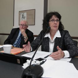North Dakota state Rep. Shirley Meyer, right, D-Dickinson, speaks during a property tax discussion on Tuesday, Sept. 11, 2012, during a meeting of the North Dakota Legislature's interim Taxation Committee in the Roughrider Room of the North Dakota Capitol in Bismarck, N.D. The committee recommended two primary bills for reducing property taxes be introduced in the 2013 Legislature. At left is state Rep. Lyle Hanson, D-Jamestown.