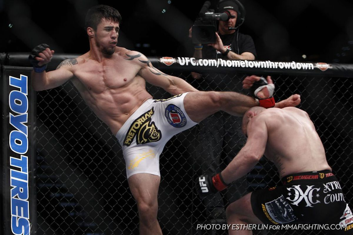 """Diego Nunes Vs. Manny Gamburyan at UFC 141, Photo by Esther Lin for <a href=""""http://www.mmafighting.com/"""" target=""""new"""">MMA Fighting</a>."""