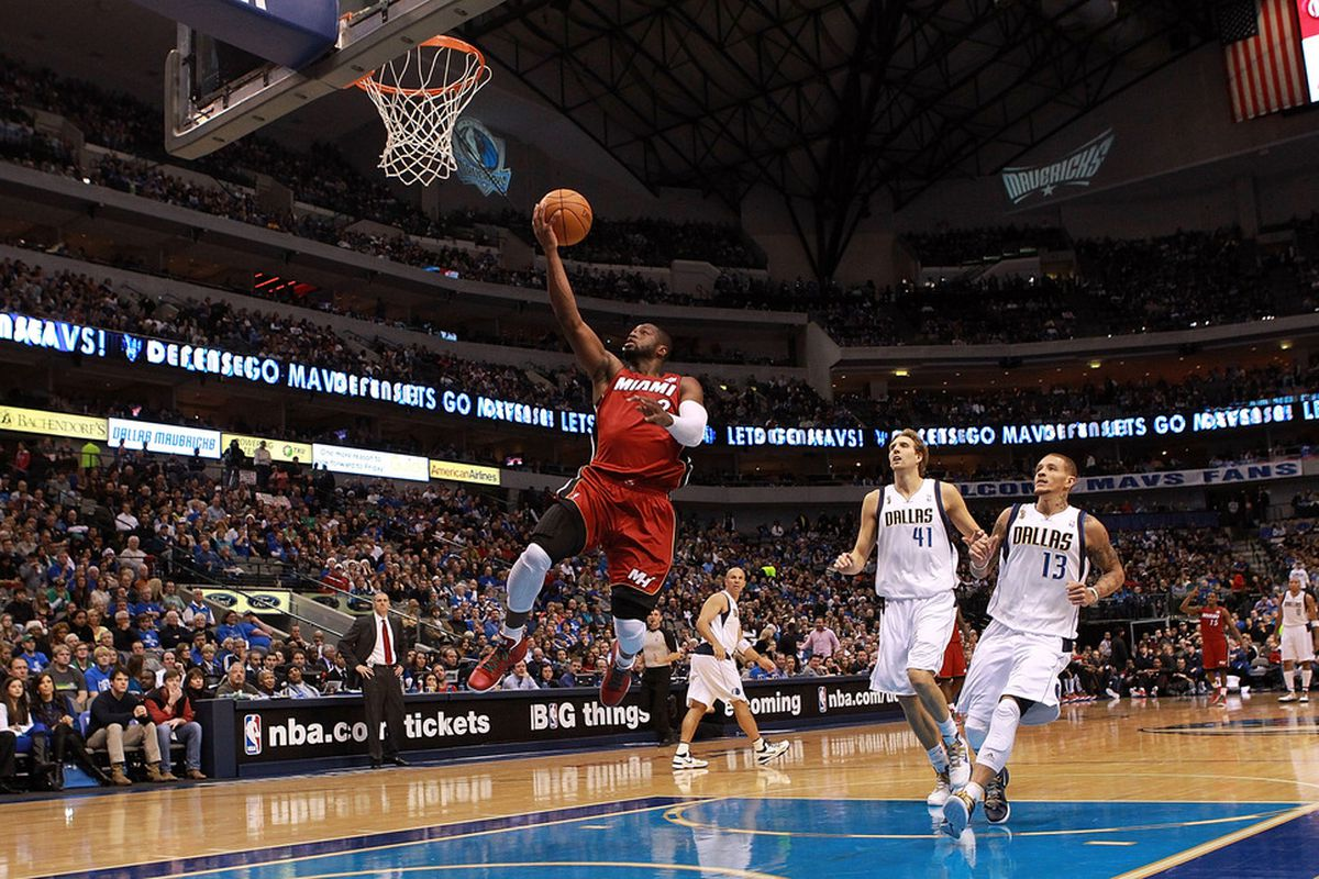 DALLAS, TX - DECEMBER 25:  Dwyane Wade #3 of the Miami Heat makes a layup against the Dallas Mavericks at American Airlines Center on December 25, 2011 in Dallas, Texas.  (Photo by Ronald Martinez/Getty Images)