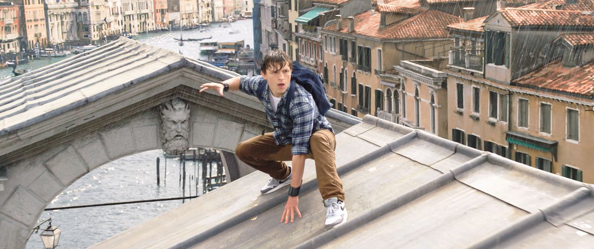 Spider-Man: Far From Home - a drenched Peter Parker on a Venice rooftop