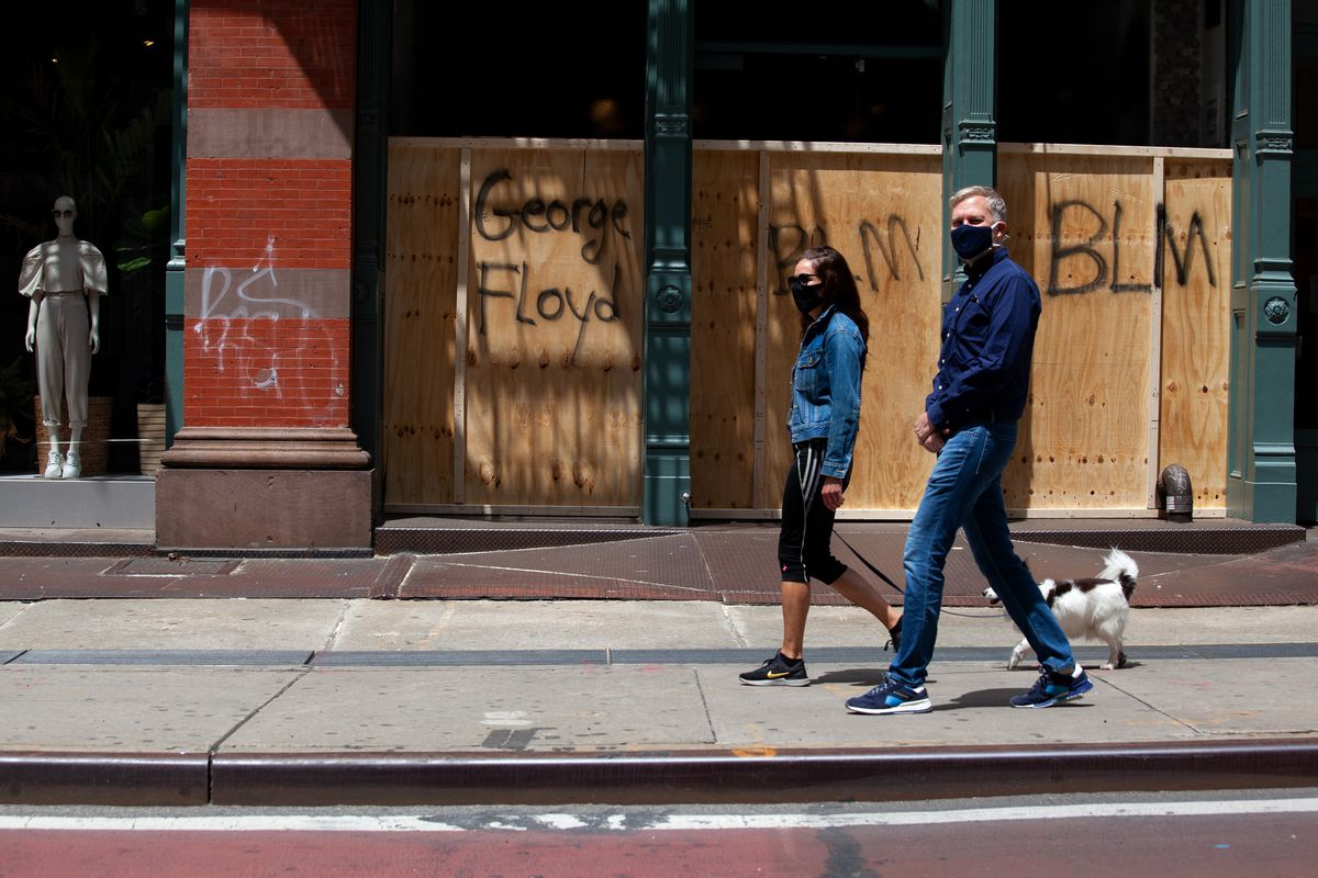 Storefronts along Broadway showed the signs of a night of clashes.