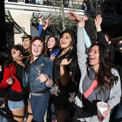 Shoppers dance in celebration before the ceremony to open City Creek Center in Salt Lake City, Thursday, March 22, 2012.
