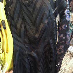 Black cap sleeve dress, $450