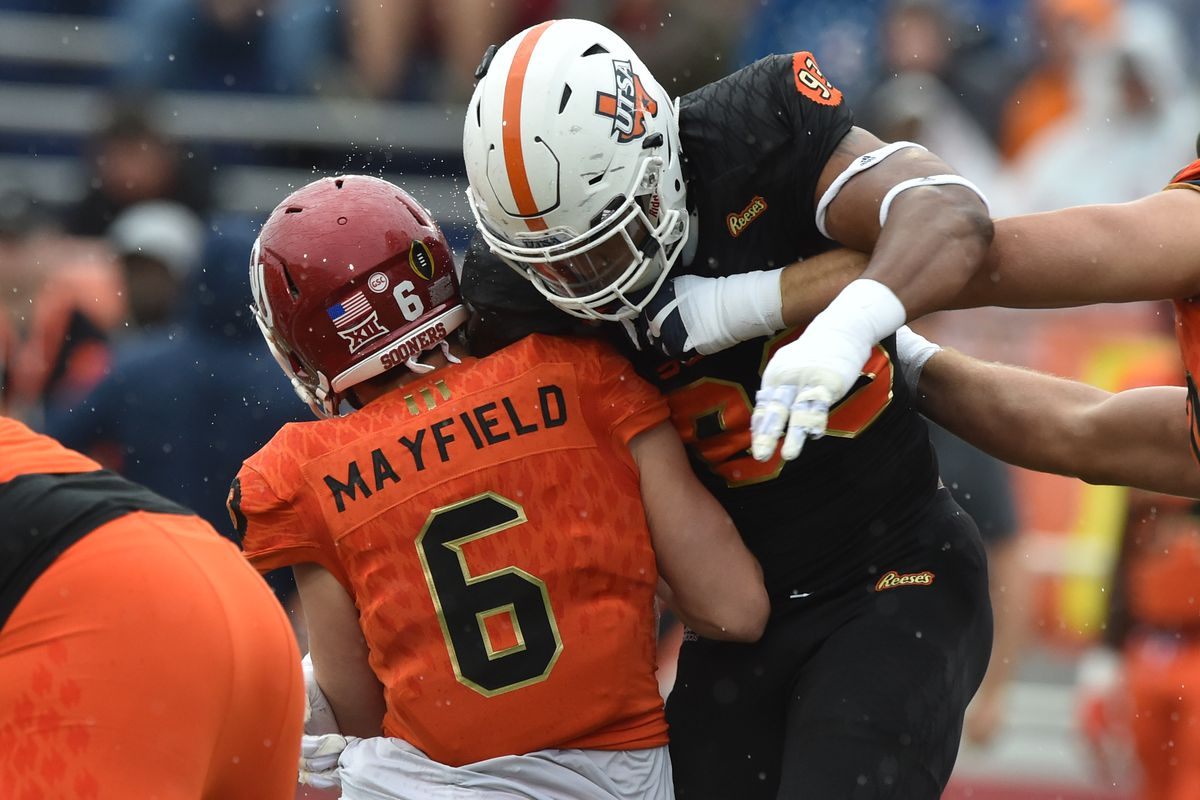 Mobile, AL - South squad defensive end Marcus Davenport of UTSA (93)  sacks North squad quarterback Baker Mayfield of Oklahoma (6) during the  first quarter of the 2018 Senior Bowl at Ladd-Peebles Stadium.