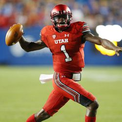 Utah Utes quarterback Tyler Huntley (1) looks to throw against the Brigham Young Cougars  in Provo on Saturday, Sept. 9, 2017.