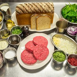 """The ingredients (top row l-r): Blanched French fries, milk, white wine, Balthazar bakery pan au levain, gelatin, fresh spinach, red onion. <br> (middle row l-r) shredded jack cheese, finished """"Béarnaise cheese"""", bay leaves, tarragon, black peppercorn, dr"""