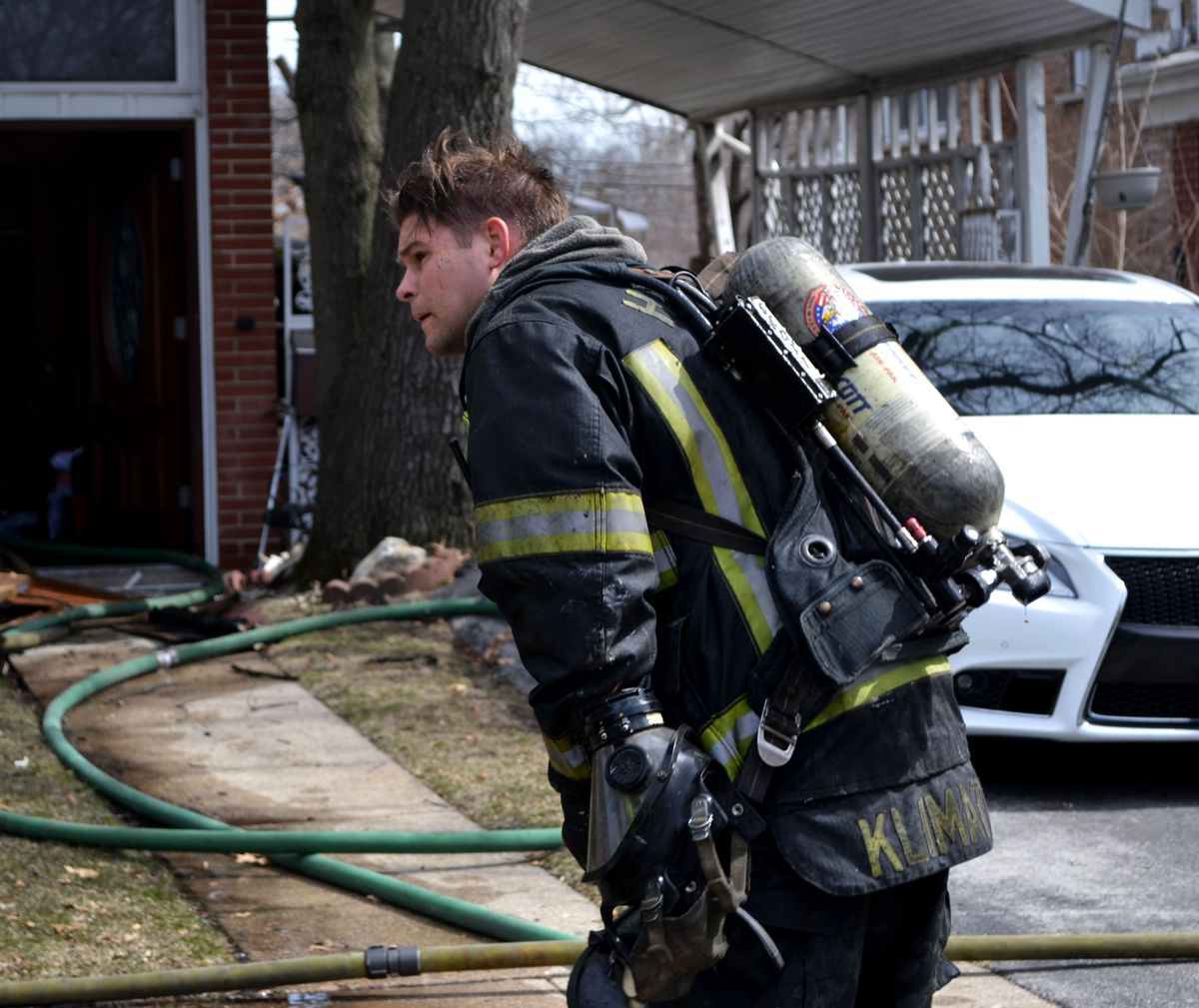 A firefighter responds to ablaze Sunday afternoon at a homein the 14800 block of Dobson Avenue in Dolton.   Justin Jackson/Sun-Times