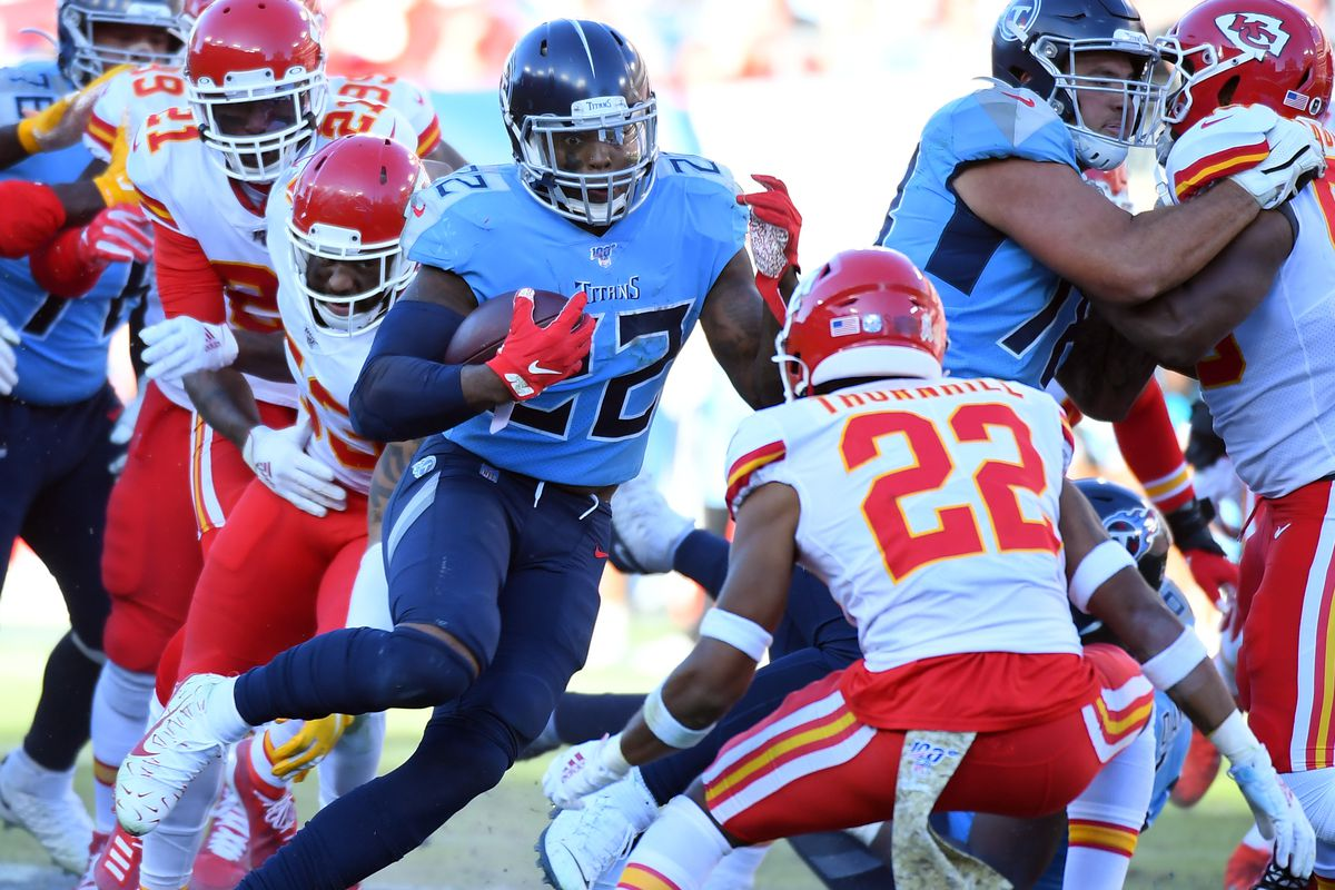 Tennessee Titans running back Derrick Henry runs for a first down against the Kansas City Chiefs during the second half at Nissan Stadium.