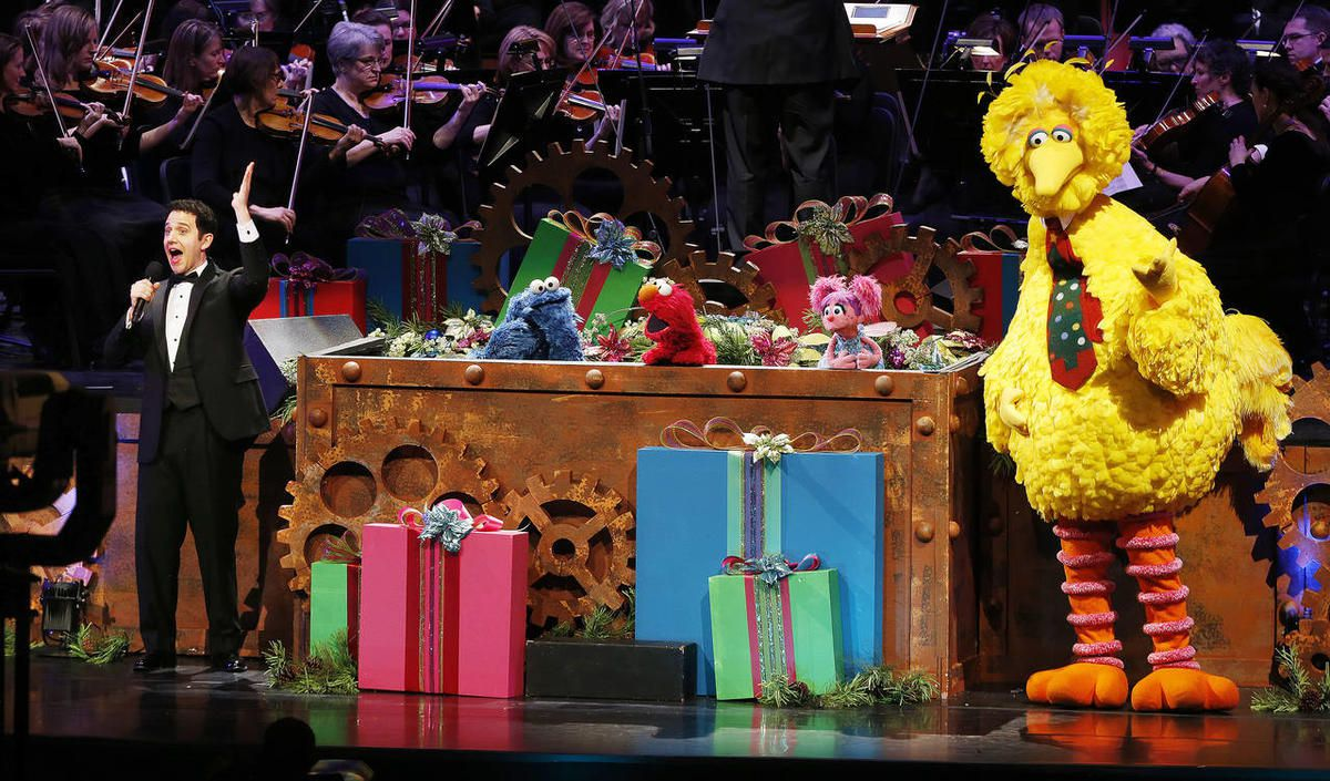 """Santino Fontana and the """"Sesame Street"""" Muppets perform with the Tabernacle Choir at Temple Square."""