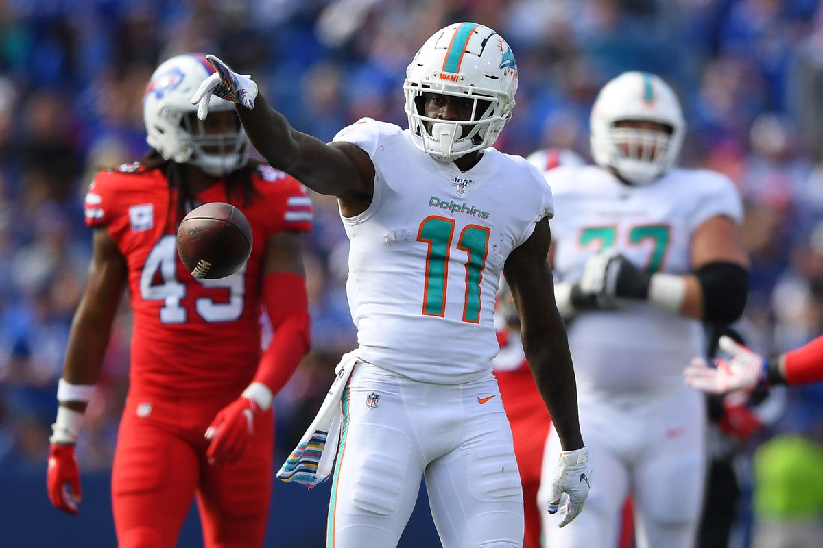 Miami Dolphins wide receiver DeVante Parker (11) reacts to his first down catch against the Buffalo Bills during the third quarter at New Era Field.