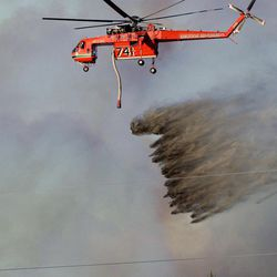 A plane drops fire retardant on a wildfire Sunday, Sept. 9, 2012 on Casper Mountain in Casper, Wyo. Residences and campgrounds were evacuated as the uncontained wildfire spread across the southeast portion of the mountain.