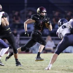Maple Mountain's Teddy Wright runs with the ball during the second round of the 5A football playoffs against Springville at Maple Mountain High School in Spanish Fork on Friday, Oct. 30, 2020. Maple Mountain won 27-21.
