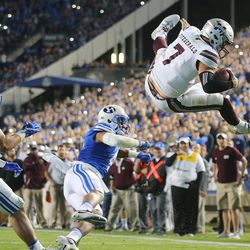 Mississippi State Bulldogs quarterback Nick Fitzgerald (7) flips into the air after being hit by Brigham Young Cougars linebacker Fred Warner (4) as he scores a touchdown in OT as BYU and Mississippi State play in Provo at LaVell Edwards Stadium on Friday, Oct. 14, 2016.