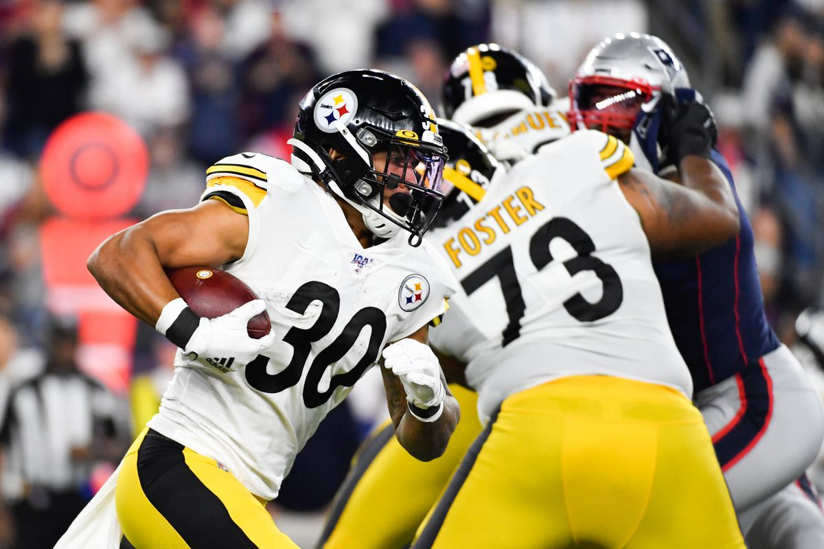 James Conner of the Pittsburgh Steelers runs the ball during the first half against the New England Patriots at Gillette Stadium on September 08, 2019 in Foxborough, Massachusetts.