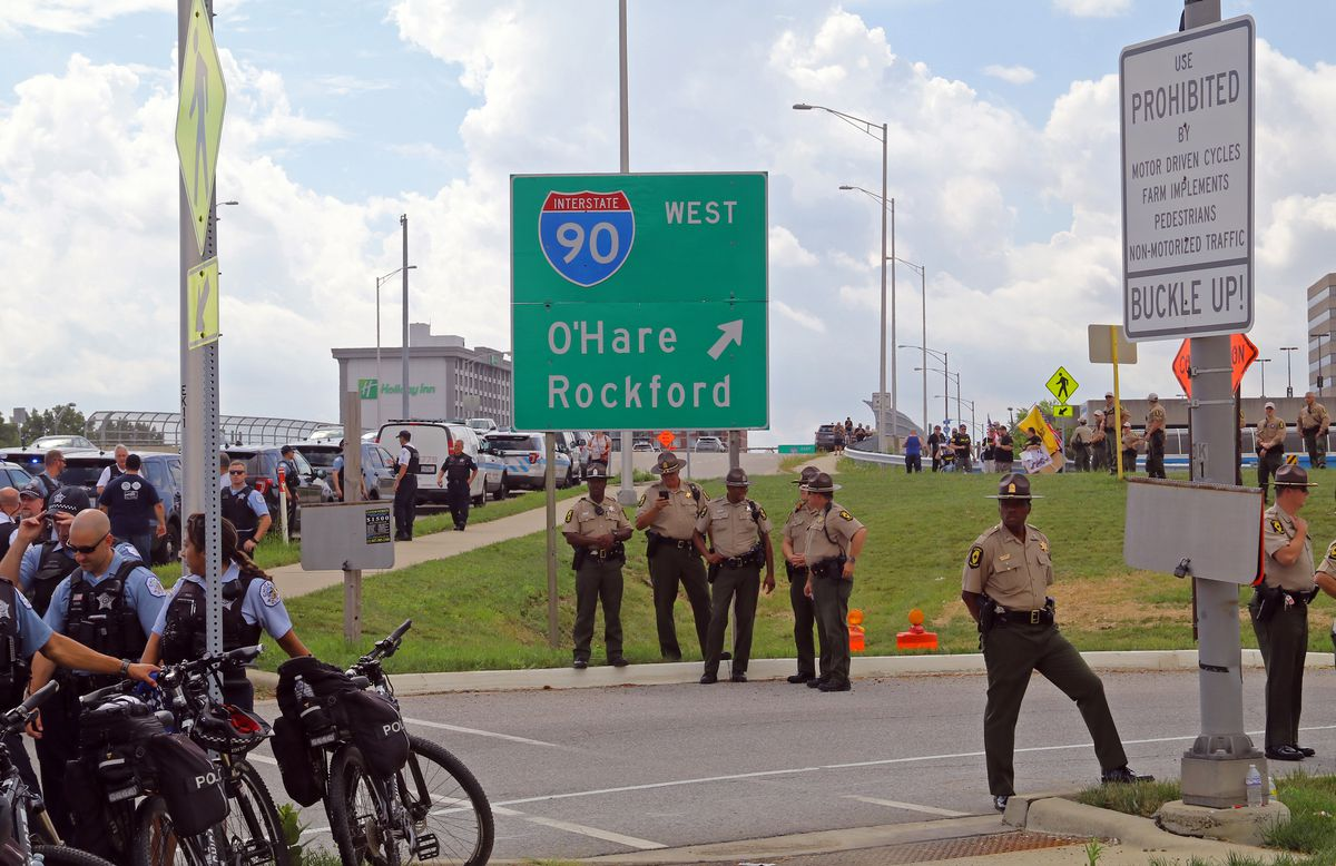 Police protest presence is seen along a ramp leading onto the Kennedy expressway on Monday. The white sign spells out that pedestrians are prohibited.   Tim Boyle/For the Sun-Times