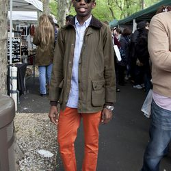 Johnny is wearing a Barbour jacket, a J.Crew shirt, Zara pants, and Sperry Top-Siders. His glasses are Ray-Bans.