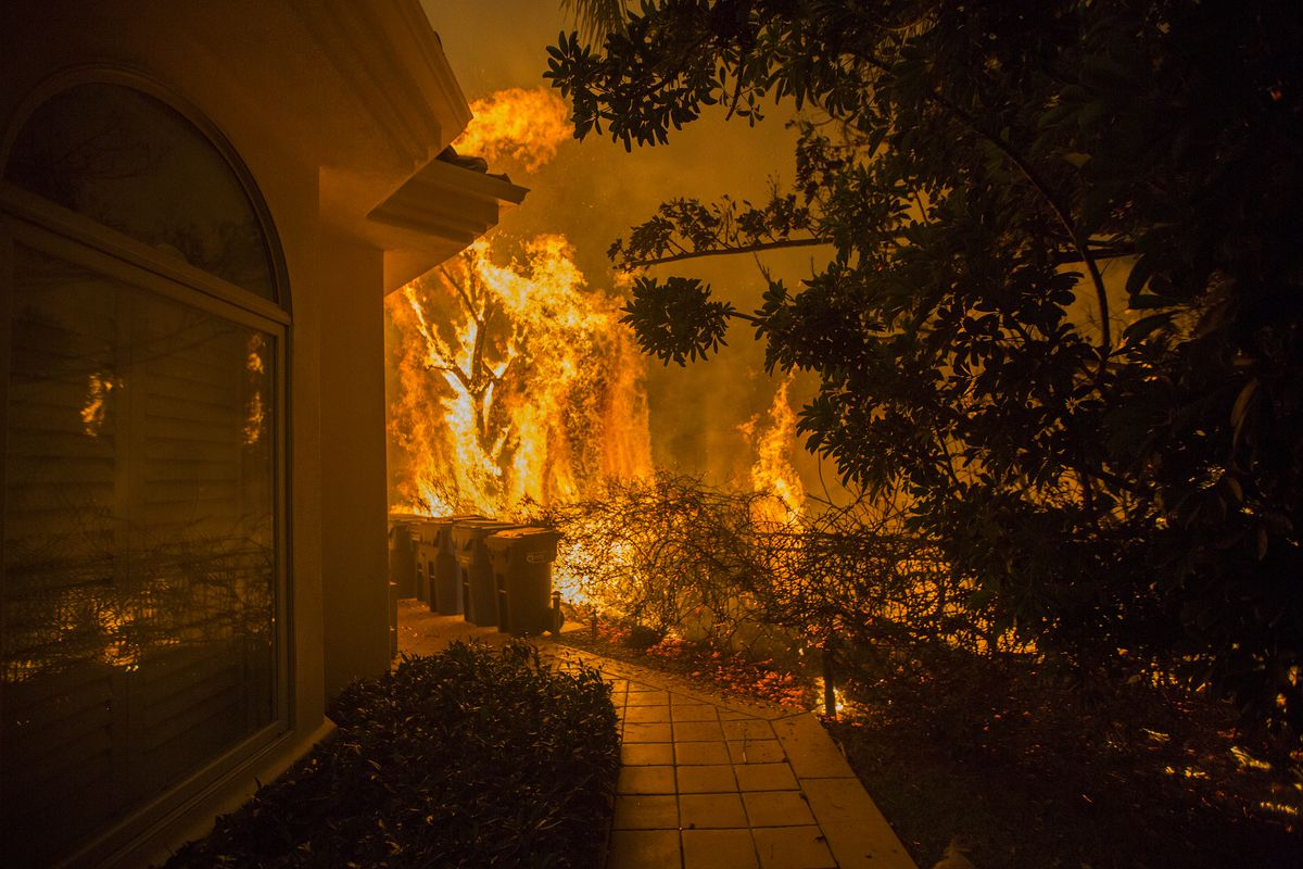 Flames approach a house during the Woolsey Fire in Malibu