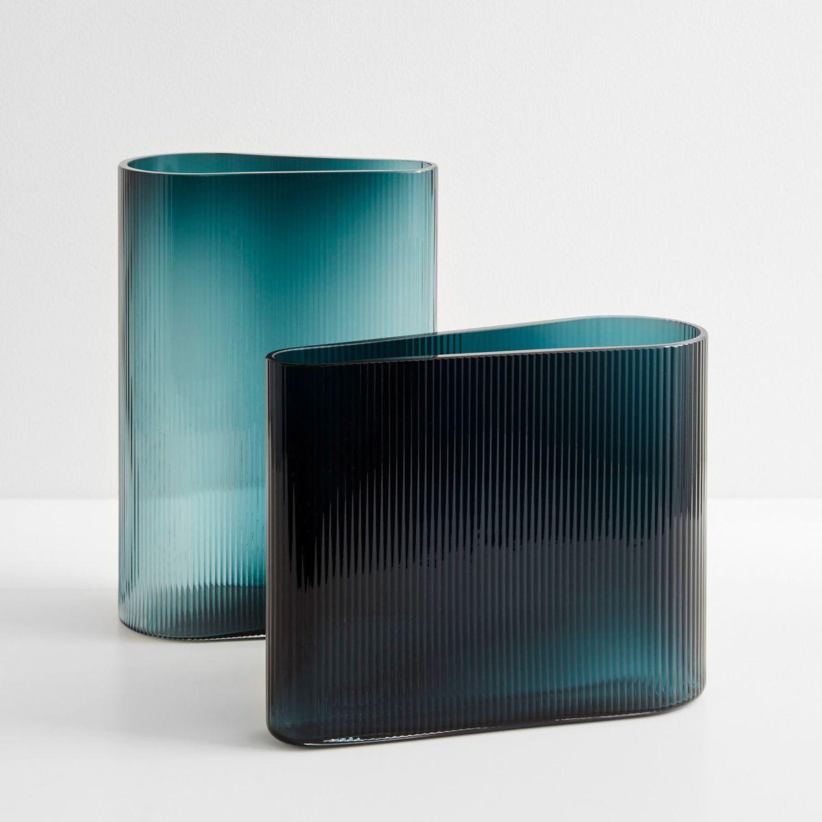 Two pieces of glassware in a dark blue color.