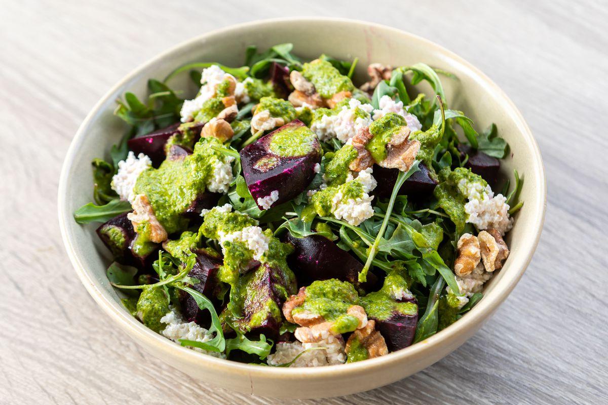 Beet and kishik salad with roasted beets, fermented yogurt, and bulgur