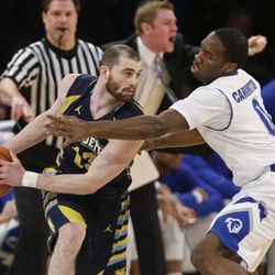 Seton Hall's Khadeen Carrington (0) defends Marquette's Matt Carlino (13) during the first half of an NCAA college basketball game in the first round of the Big East Conference tournament, Wednesday, March 11, 2015, in New York. (AP Photo/Frank Franklin II)