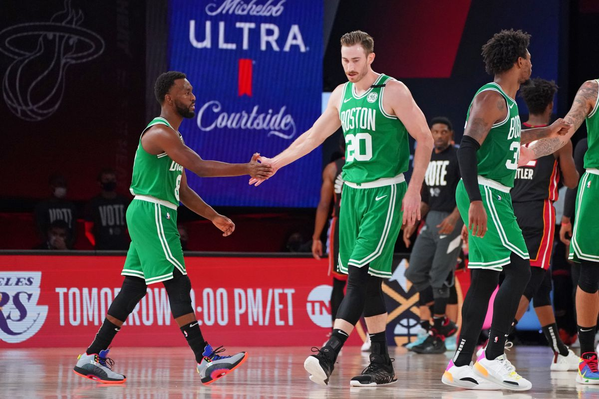 Kemba Walker of the Boston Celtics and Gordon Hayward of the Boston Celtics high-five during Game Four of the Eastern Conference Finals of the NBA Playoffs on September 23, 2020 at the AdventHealth Arena at ESPN Wide World Of Sports Complex in Orlando, Florida.