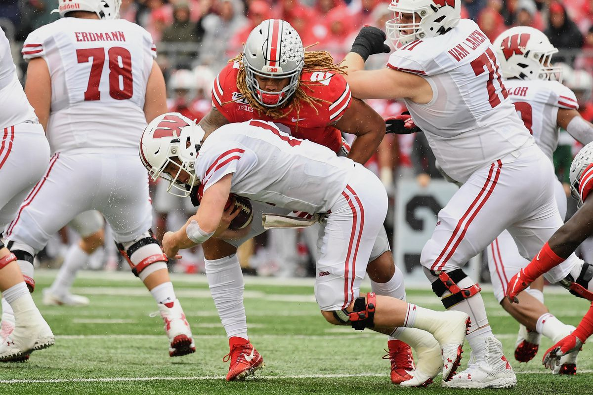 Chase Young of the Ohio State Buckeyes makes a tackle against the Wisconsin Badgers at Ohio Stadium on October 26, 2019 in Columbus, Ohio.