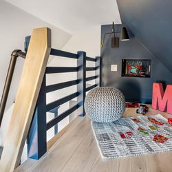 Opening up the small attic created space for this hideaway loft in a child's bedroom, ready for play, study, quiet reading, or a sleepover.