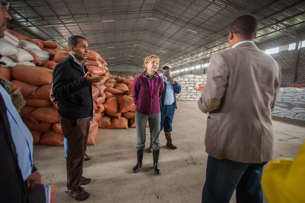 Desmond-Hellman speaks with representatives during a tour of the Ada-Lume Cooperative Union facilities in Ethiopia last July.