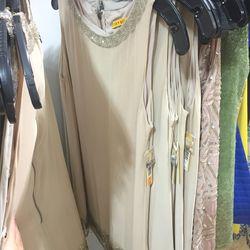 Beige dress with beaded neckline, $199 (was $484)