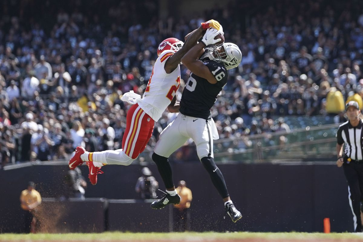 Oakland Raiders wide receiver Tyrell Williams catches a pass against Kansas City Chiefs cornerback Bashaud Breeland during the first quarter at Oakland Coliseum.