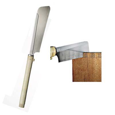 A Dozuki Japanese hand saw being used to cut wood.